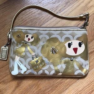 "LIMITED EDITION ""GOLDY"" COACH WRISTLET"